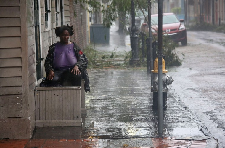 Julia Wilson sits and watches as rain from Hurricane Isaac falls over Bourbon Street on August 29, 2012 in New Orleans, Louisiana. (John Moore/Getty Images)