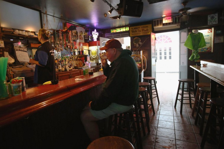 Tim Janson drinks a vodka tonic at the Funky Pirate bar as a morning rain from Hurricane Isaac falls over Bourbon Street on August 29, 2012 in New Orleans, Louisiana. (John Moore/Getty Images)