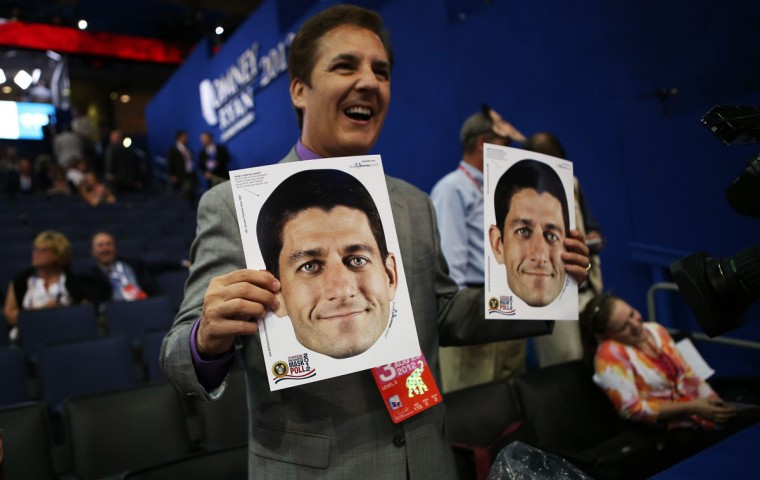 David Karst of Milwaukee, WI holds headshots of Republican vice presidential candidate, U.S. Rep. Paul Ryan (R-WI) during the third day of the Republican National Convention at the Tampa Bay Times Forum on August 29, 2012 in Tampa, Florida. (Chip Somodevilla/Getty Images)