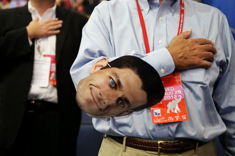 A man holds a cut-out headshot of Republican vice presidential candidate, U.S. Rep. Paul Ryan (R-WI) during the third day of the Republican National Convention at the Tampa Bay Times Forum on August 29, 2012 in Tampa, Florida. (Chip Somodevilla/Getty Images)