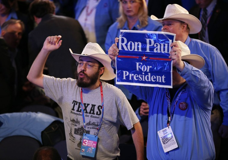 A supporter of U.S. Rep. Ron Paul (R-TX) holds a sign during the third day of the Republican National Convention at the Tampa Bay Times Forum on August 29, 2012 in Tampa, Florida. (Win McNamee/Getty Images)