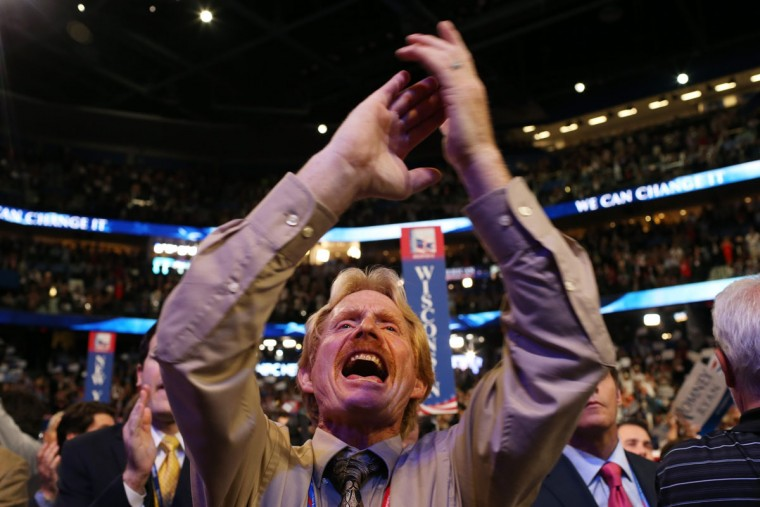 A man cheers as Republican vice presidential candidate, U.S. Rep. Paul Ryan (R-WI) speaks during the third day of the Republican National Convention at the Tampa Bay Times Forum on August 29, 2012 in Tampa, Florida. (Spencer Platt/Getty Images)