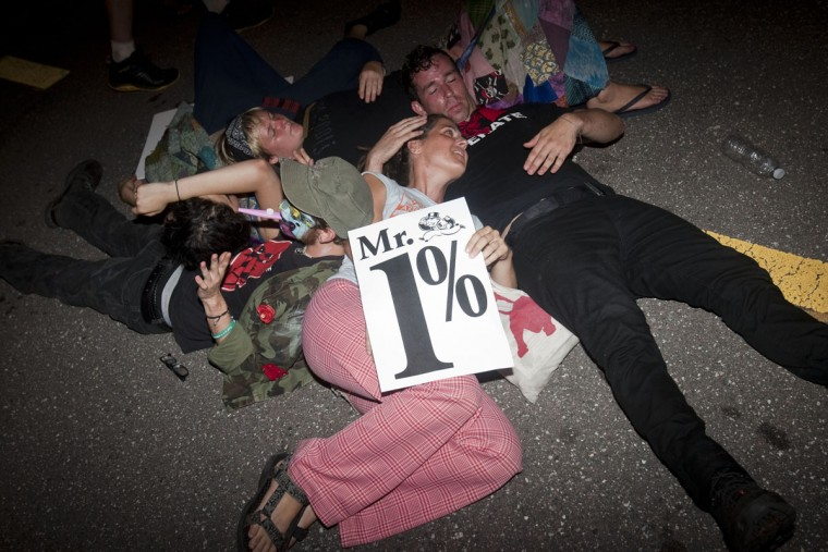 Protesters lie in a group during the Republican National Convention on August 29, 2012 in Tampa, Florida. The marchers remained peaceful and were allowed to make their own route through downtown. (Edward Linsmier/Getty Images)