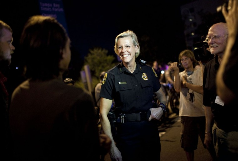 Protesters speak with Tampa Police Chief Jane Castor while marching during the Republican National Convention on August 29, 2012 in Tampa, Florida. The marchers remained peaceful and were allowed to make their own route through downtown. (Edward Linsmier/Getty Images)