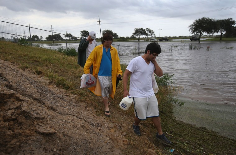 Residents carry supplies to their homes in an area partially flooded from Hurricane Isaac in Slidell, Louisiana in St. Tammany Parish. (John Moore/Getty Images)