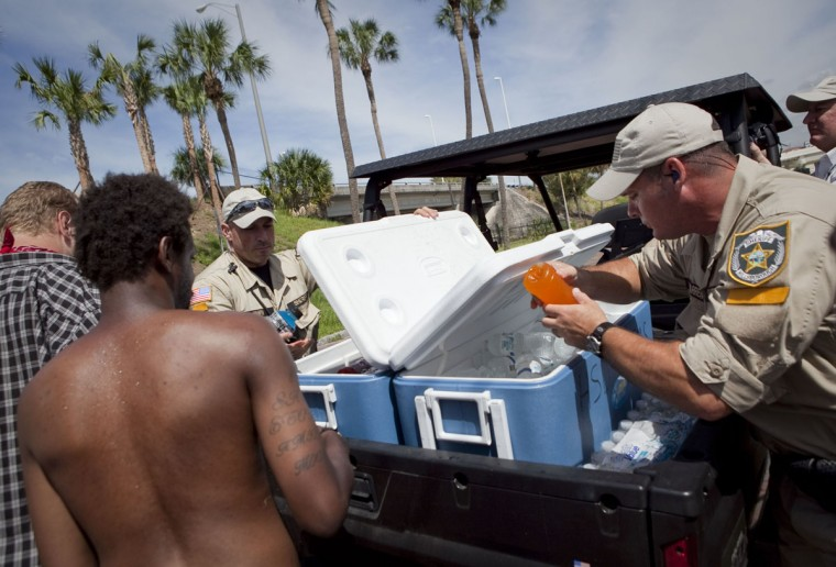 Sheriff's Deputies from Hillsborough and Osceola Counties pass out drinks to protesters in the Romneyville camp during the Republican National Convention in Tampa, Florida. Law enforcement officials also distributed surplus food to the Romneyville camp. (Edward Linsmier/Getty Images)