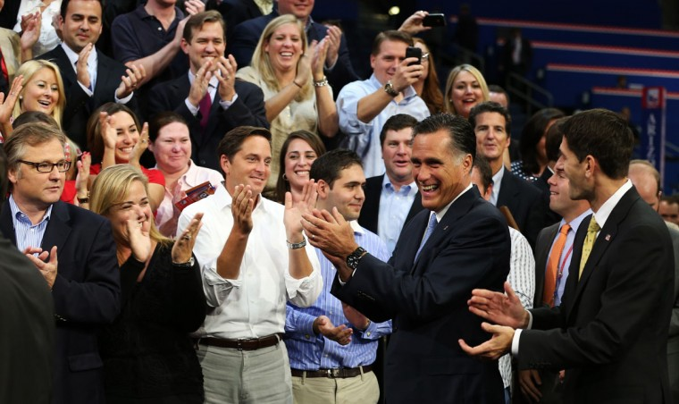 Republican presidential candidate, former Massachusetts Gov. Mitt Romney (2R) and Republican vice presidential candidate, U.S. Rep. Paul Ryan (R-WI) (R) clap after posing with campaign staffers for a photo during the final day of the Republican National Convention at the Tampa Bay Times Forum in Tampa, Florida. (Chip Somodevilla/Getty Images)