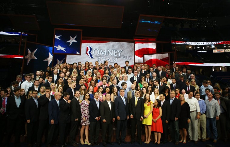 Republican presidential candidate, former Massachusetts Gov. Mitt Romney and Republican vice presidential candidate, U.S. Rep. Paul Ryan (R-WI) pose with campaign staffers for a photo during the final day of the Republican National Convention at the Tampa Bay Times Forum in Tampa, Florida. (Chip Somodevilla/Getty Images)