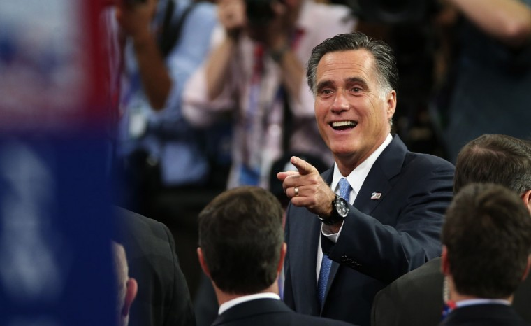 Republican presidential candidate, former Massachusetts Gov. Mitt Romney walks the floor during the final day of the Republican National Convention at the Tampa Bay Times Forum in Tampa, Florida. (Win McNamee/Getty Images)
