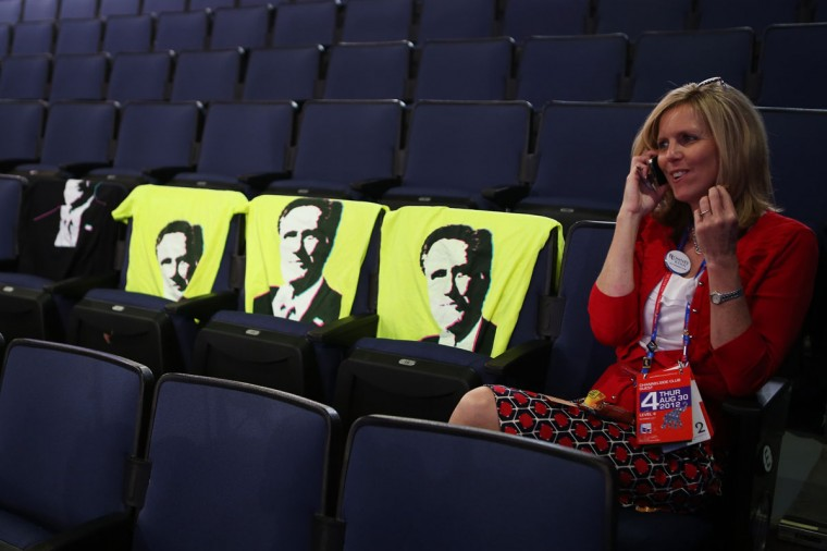 Kalleen Land of Utah sits next to t-shirts of Republican presidential candidate, former Massachusetts Gov. Mitt Romney during the final day of the Republican National Convention at the Tampa Bay Times Forum in Tampa, Florida. (Chip Somodevilla/Getty Images)