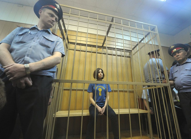 "MOSCOW, RUSSIA - JULY 4: Nadezhda Tolokonnikova, a member of female Russian punk band Pussy Riot, sits inside a defendants cage in a Moscow court, on July 4, 2012, during the hearings on the Pussy Riot case. Three members of the all-woman punk band ""Pussy Riot"" were detained two months ago, after they climbed on the altar of Moscow's Christ the Saviour Cathedral -- the country's central place of worship -- and sang a song they called a ""Punk Prayer"". (Alexander Nemenov/AFP/Getty Images)"