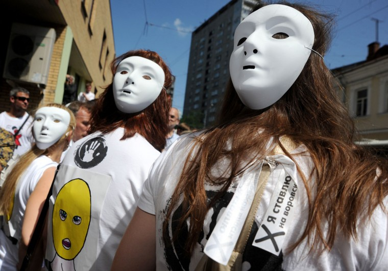 MOSCOW, RUSSIA - JULY 4: Supporters of female Russian punk band Pussy Riot rally outside a Moscow court, on July 4, 2012, during the hearings on the Pussy Riot case. (Andrey Smirnov/AFP/Getty Images)