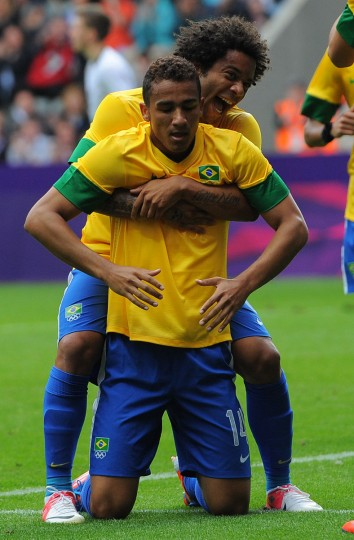 Brazil's defender Danilo (L) celebrates with Brazil's defender Marcelo after scoring during the London 2012 Olympic Games men's football match between Brazil and New Zealand at St James' Park in Newcastle, north-east England on August 1, 2012. (Andrew Yates/AFP/Getty Images)