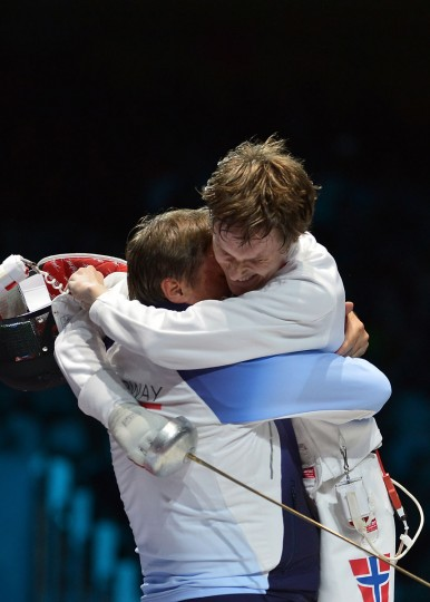 Norway's Bartosz Piasecki celebrates with his coach his victory over South Korea's Jung Jinsun at the end of their Men's epee semi final bout as part of the fencing event of London 2012 Olympic games, on August 1, 2012 at the ExCel centre in London. (Alberto Pizzoli/AFP/Getty Images)
