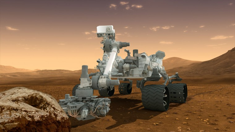August 1, 2012: An artist's conception of NASA's Mars Science Laboratory Curiosity rover shows the mobile robot investigating Mars' past or present ability to sustain microbial life. (NASA/JPL-Caltech/ASU/HO/AFP/Getty Images)
