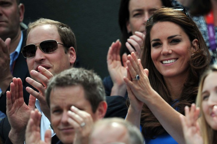Britain's Catherine and William, the Duchess and Duke of Cambridge, applaud while Britain's Andy Murray plays against Spain's Nicolas Almagro a London 2012 Olympic Games men's singles quarterfinal match at Wimbledon, in south London, on August 2, 2012. (Martin Bernetticarl Court/AFP/Getty Images)