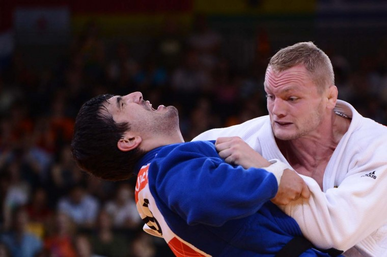 Germany's Dimitri Peters competes with Russia's Tagir Khaibulaev (blue) during their men's -100kg judo contest semi-final match of the London 2012 Olympic Games on August 2, 2012 at the ExCel arena in London. (Franck Fife/AFP/Getty Images)