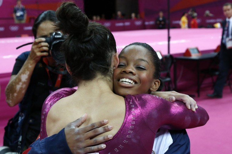 US gymnast Gabrielle Douglas (R) celebrates with teammate Alexandra Raisman after winning the artistic gymnastics women's individual all-around final at the 02 North Greenwich Arena in London on August 2, 2012 during the London 2012 Olympic Games. (Thomas Coex/AFP/Getty Images)
