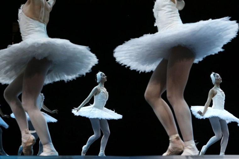 "Dancers from the English National Ballet perform ""Swan Lake"" ahead of the artistic gymnastics women's individual all-around final event at the 02 North Greenwich Arena in London on August 2, 2012 during the London 2012 Olympic Games. (Thomas Coex/AFP/Getty Images)"