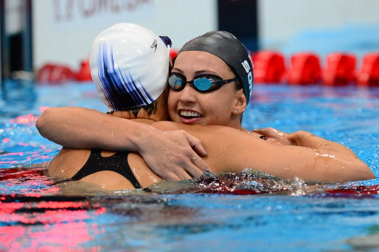 US swimmer Rebecca Soni (R) embraces US swimmer Micah Lawrence (L) after winning gold and breaking the world record in the women's 200m breaststroke final swimming event at the London 2012 Olympic Games on August 2, 2012 in London. (Martin Bureau/AFP/Getty Images)