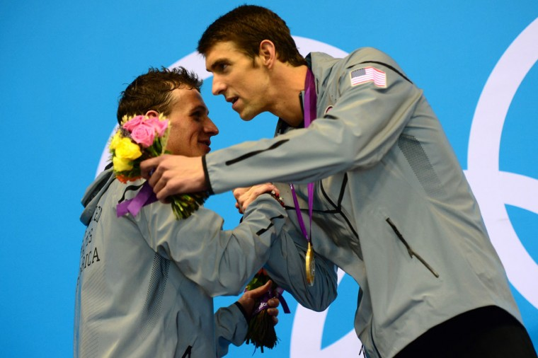 Gold medalist US swimmer Michael Phelps (R) embraces silver medalist US swimmer Ryan Lochte on the podium after winning the men's 200m individual medley swimming event at the London 2012 Olympic Games on August 2, 2012 in London. (Christophe Simon/AFP/Getty Images)