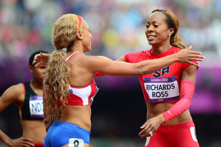US' Sanya Richards-Ross (R) greets Puerto Rico's Carol Rodriguez after competing in the women's 400m heats at the athletics event during the London 2012 Olympic Games on August 3, 2012 in London. (Olivier Morin/AFP/Getty Images)