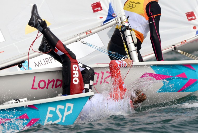 Croatia's Tina Mihelic falls from her dinghy in the Laser Radial sailing class at the London 2012 Olympic Games, in Weymouth. (William West/AFP/Getty Images)