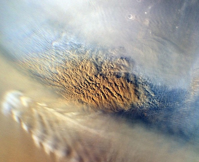 August 2, 2012: This NASA close-up image of a dust storm on Mars was acquired by the Mars Color Imager instrument on NASA's Mars Reconnaissance Orbiter on November 7, 2007, around 3 p.m. local time on Mars. Scientists working with NASA's Curiosity rover, which is set to land on Mars on August 5, 2012 PDT (August 6 EDT), are monitoring Mars each day for similar small storms that could either drift over the landing site or stir up dust that moves as haze over the site. This image is centered on Utopia Planitia (53.6 degrees north latitude, 147.9 degrees east longitude), along the north seasonal polar cap edge in late northern winter. (NASA/JPL-CALTECH/MSSS HO/AFP/Getty Images)