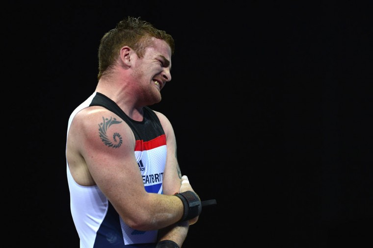 Britain's Peter Kirkbride reacts after a failed attempt during the men's 94kg group B weightlifting event of the London 2012 Olympic Games at The Excel Centre in London on August 4, 2012. (Yuri Cortez/AFP/Getty Images)