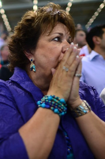 Debbie Phelps, Michael Phelp's mother, reacts after he son competed and won gold in the men's 4x100m medley relay final during the swimming event at the London 2012 Olympic Games on August 4, 2012 in London. (Christophe Simon/AFP/Getty Images)
