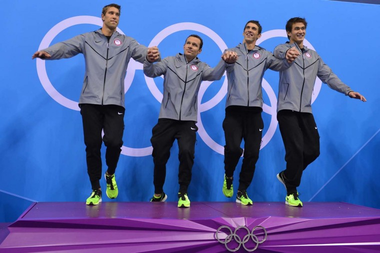 U.S. swimmers Matthews Grevers, Brendan Hansen, Michael Phelps and Adrian Nathan pose on the podium after winning gold in the men's 4x100 medley relay final during the swimming event at the London 2012 Olympic Games on August 4, 2012 in London. (Fabrice Coffrini/AFP/Getty Images)