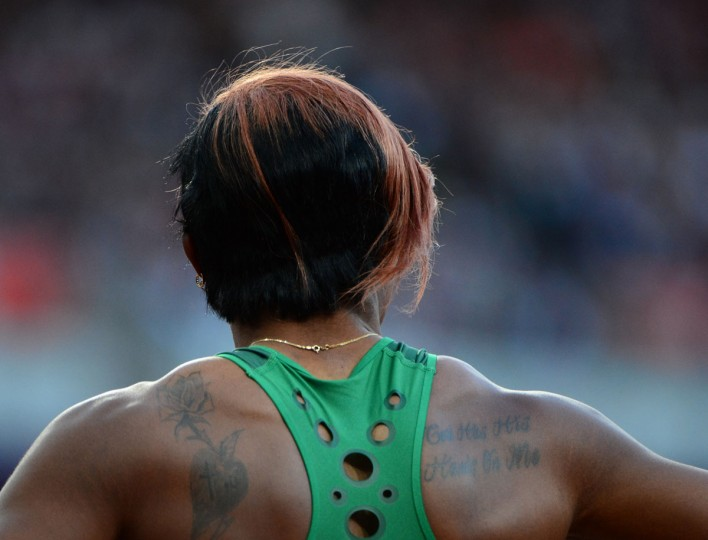 The tattoos on Nigeria's Blessing Okagbare's back are shown while she competes in the women's 100m semifinal at the athletics event of the London 2012 Olympic Games on August 4, 2012 in London. (Olivier Morin/AFP/Getty Images)