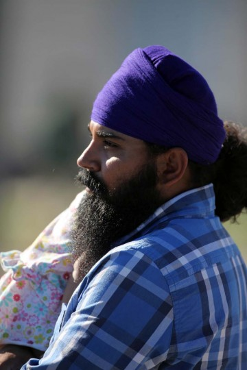 A Sikh man holds his daughter near the Sikh Temple of Wisconsin where six people were killed when a gunman fired during a service on August, 5, 2012 in Oak Creek, Wisconsin. (Tasos Katopdois/AFP/Getty Images)