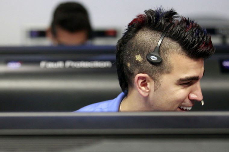 August 5, 2012: Activity lead Bobak Ferdowsi, who cuts his hair differently for each mission, works inside the Spaceflight Operations Facility for NASA's Mars Science Laboratory Curiosity rover at Jet Propulsion Laboratory (JPL) in Pasadena, California. (Brian van der Brug/AFP/Getty Images)