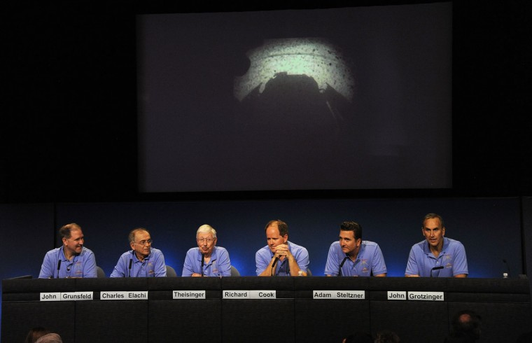 August 5, 2012: Mars Science Laboratory (MSL) Curiosity Rover mission managers, flight controllers, scientists and administrators speak at a press conference after the Mars Rover Curiosity successfully landed on the surface of the Red Planet at the Jet Propulsion Laboratory in Pasadena, California. (Robyn Beck/AFP/Getty Images)