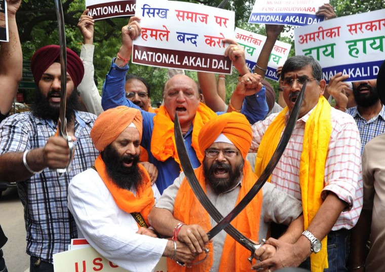 NEW DELHI - AUGUST 6: Activists of the National Akali Dal shout anti-US slogans during a protest in New Delhi on August 6, 2012, after a gunman in the US shot worshippers at a suburban Sikh temple in Wisconsin. (Hussain Sajjad/AFP/Getty Images)