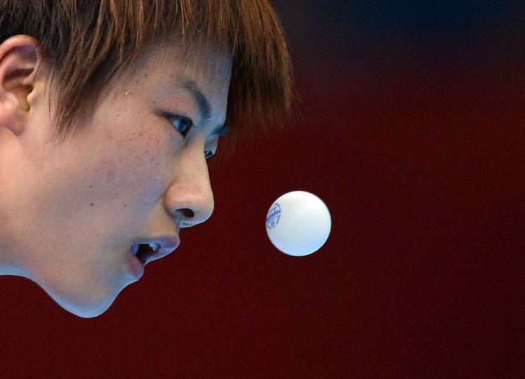 China's Ding Ning eyes the ball as she competes against South Korea's Kim Kyungah in the Women's Semifinal between China and South Korea of the London 2012 Olympic Games in London on August 6, 2012. (Saeed Khan/AFP/Getty Images)