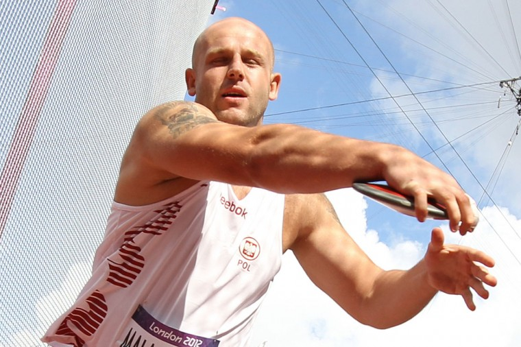 Poland's Piotr Malachowski competes in the men's discus throw qualifications at the athletics event of the London 2012 Olympic Games on August 6, 2012 in London. (Adrian Dennis/AFP/Getty Images)