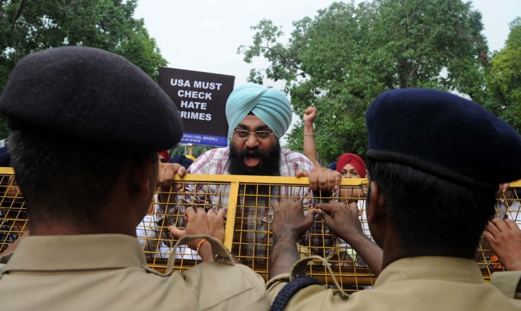 AUGUST 6: Activists of the Shiromani Akali Dal shout anti-US slogans during a protest near the U.S. embassy in New Delhi on August 6, 2012, after a gunman in the U.S. shot worshipers at a suburban Sikh temple in Wisconsin. (Hussain Sajjad/AFP/Getty Images)