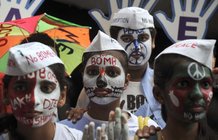 Indian students paint their faces with anti-nuclear messages for a rally marking the 67th anniversary of the world's first atomic bombing over Hiroshima by the U.S., in Mumbai on August 6, 2012. (Punit Paranje/AFP/Getty Images)