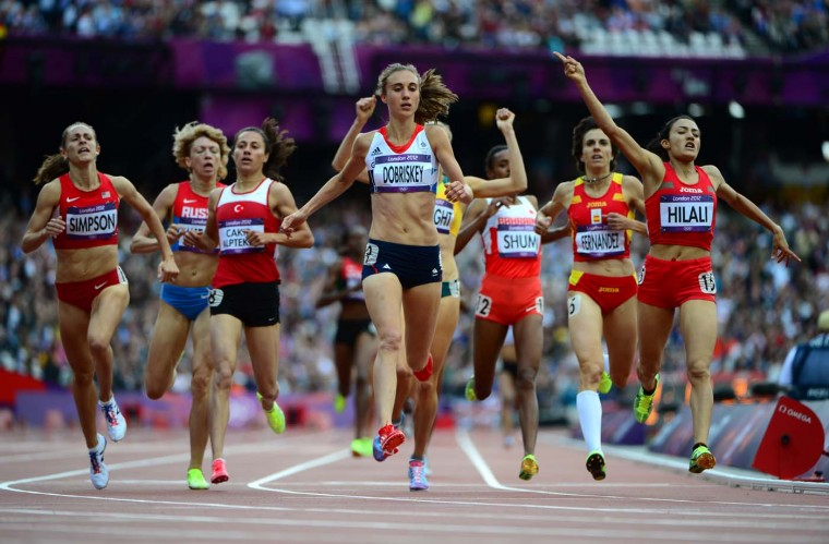 US' Jennifer Simpson (L) Britain's Lisa Dobriskey (C) and Morocco's Siham Hilali compete in the women's 1500m heats at the athletics event of the London 2012 Olympic Games on August 6, 2012 in London. (Olivier Morin/AFP/Getty Images)