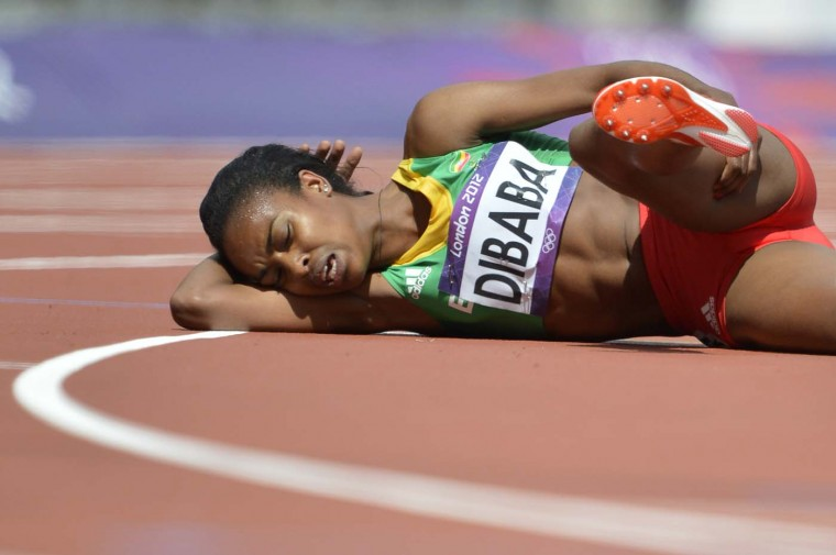 Ethiopia's Genzebe Dibaba reacts in pain after finishing her women's 1500m heat at the athletics event at the London 2012 Olympic Games on August 6, 2012 in London. (Eric Feferberg/AFP/Getty Images)