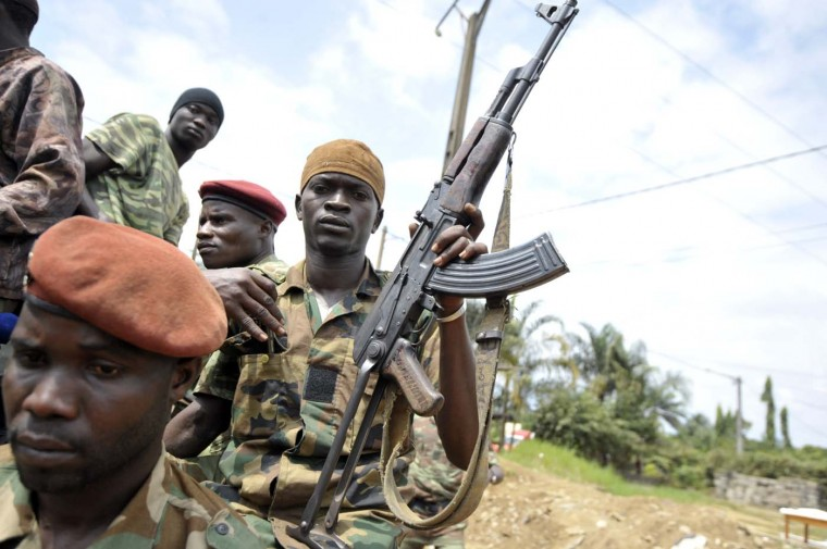A patrol of the Ivory Coast Republican Force (FRCI) ride to a search operation on August 6, 2012 in Bingerville, a town near Abidjan. A raid on an army base in Abidjan left at least six dead in the latest of a string of attacks targeting the military in the Ivory Coast economic capital. (Issouf Sango/AFP/Getty Images)