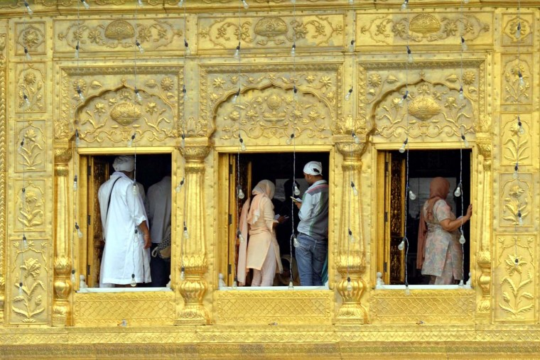 AUGUST 6: Indian Sikh devotees pay their respects at the Golden Temple in Amritsar on August 6, 2012. Indian Sikhs, led by Prime Minister Manmohan Singh, voiced shock and anger August 6 at the killing of worshippers at a Sikh temple in the US, with some suggesting American Muslims may have been the intended target. (Narinder Nanu/AFP/Getty Images)