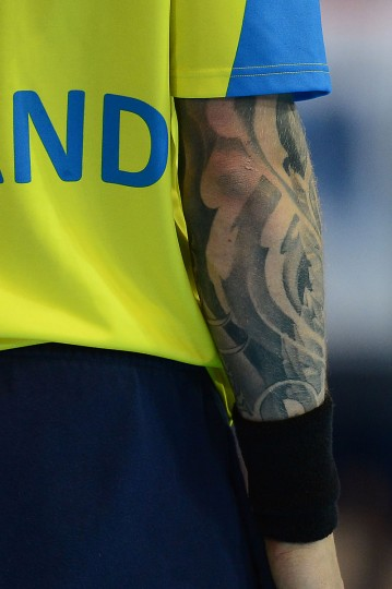 A tattoo on the right arm of Iceland's goalkeeper Bjorgvin Pall Gustafsson is seen during the men's preliminary Group A handball match Iceland vs Great Britain for the London 2012 Olympics Games on August 6, 2012 at the Copper Box hall in London. (Javier Soriano/AFP/Getty Images)