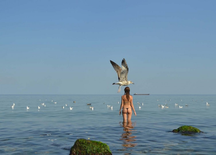 A seagull passes a girl preparing to refresh herself during +35C heat in Black Sea village of Zatoka, some 60 km from the Ukrainian city of Odessa on August 5, 2012. (Sergei Supinsky/AFP/Getty Images)