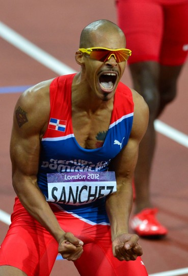 Dominican Republic's Felix Sanchez celebrates after winning the men's 400m hurdles final at the athletics event of the London 2012 Olympic Games on August 6, 2012 in London. (Gabriel Bouys/AFP/Getty Images)