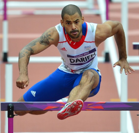 France's Garfield Darien competes in the men's 110m hurdles heats at the athletics event during the London 2012 Olympic Games on August 7, 2012 in London. (Gabriel Bouys/AFP/Getty Images)