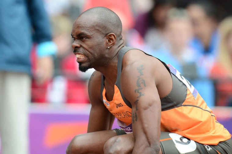 Churandy Martina of The Netherlands grimaces prior to competing in the men's 200m heats at the athletics event during the London 2012 Olympic Games on August 7, 2012 in London. (Franck Fife/AFP/Getty Images)