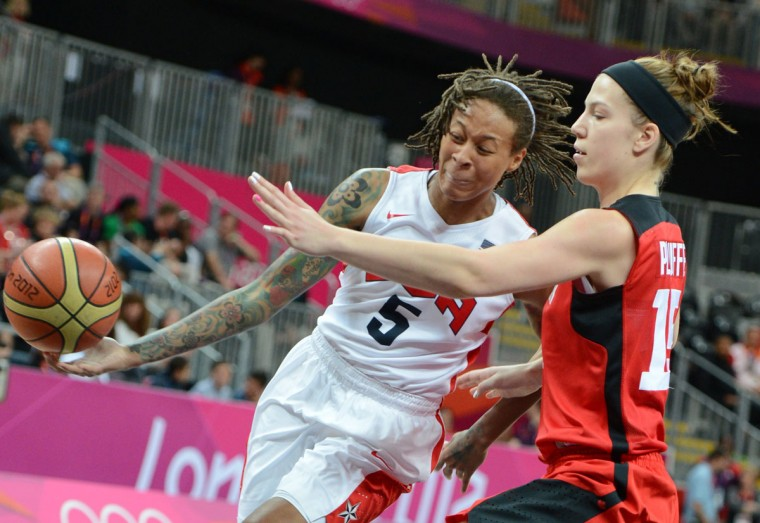 US guard Seimone Augustus (L) vies with Canadian forward Michelle Plouffe during the women's quarter final basketball match USA vs Canada at the London 2012 Olympic Games on August 7, 2012 at the North Greenwich arena in London. (Mark Ralston/AFP/Getty Images)